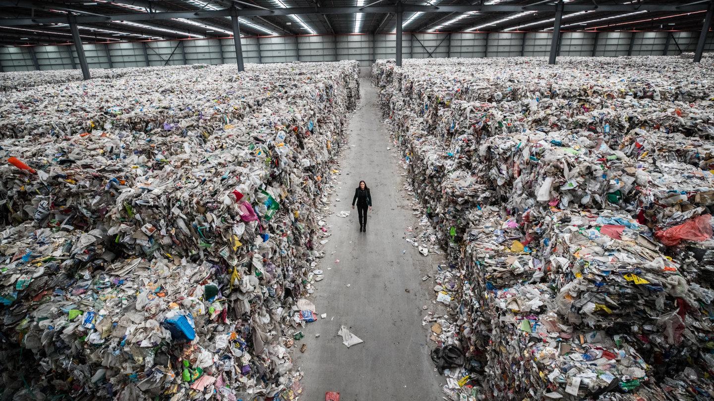 Carly Whitington walks through her company's Derrimut warehouse, which is filled with recyclable waste put there by insolvent company SKM.