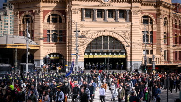 Protesters gather outside Flinders Street Station on Saturday.