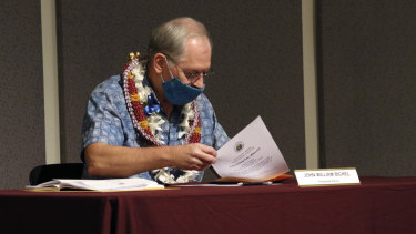 Elector John William Bickel puts his ballot in an envelope at the Hawaii State Capitol after voting for President-elect Joe Biden in the Electoral College in Honolulu on December 14.