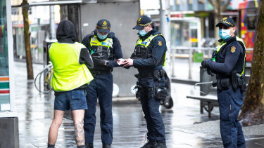 Protective Services Officers patrolling and issuing fines in Melbourne's CBD.