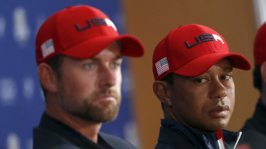 Languishing: Webb Simpson (left) and a weary Tiger Woods after the US lost to Europe in the Ryder Cup.