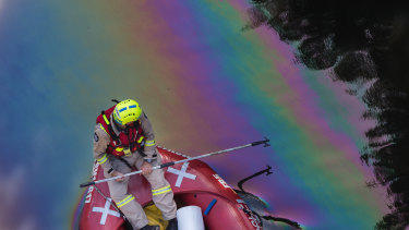 Fire crews mop up an oil spill on The Yarra river, near the Barkers Road bridge in Kew.
