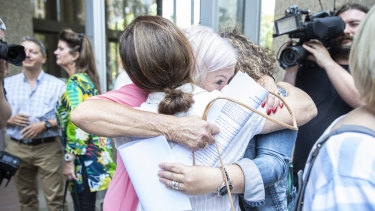 Women hug outside court after the findings in the pelvic mesh judgment were delivered in November 2019.