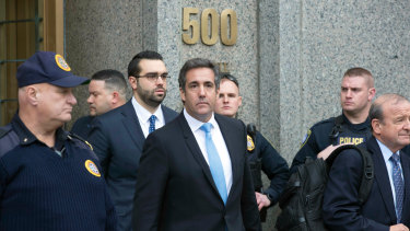 Michael Cohen, centre, President Donald Trump's personal lawyer, leaves federal court in New York last week.
