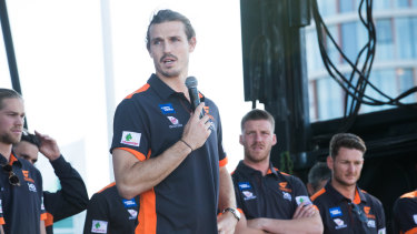 Phil Davis addresses fans at the Giants' Olympic Park base on Sunday, the day after losing the grand final.