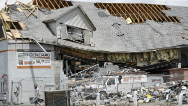 Pedestrians pass along storm debris in Dayton, Ohio.