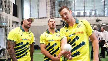 Josh Hazlewood (right), gives some pointers to NRL duo Andrew Fifita (left) and Adam Elliott in Sydney in February.
