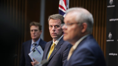 Education Minister Dan Tehan (centre) said the $1.6 billion temporary overhaul will begin from Sunday night.