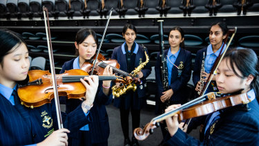 At MLC School, string players can rehearse but woodwind players are not allowed under new COVID-19 rules for schools.