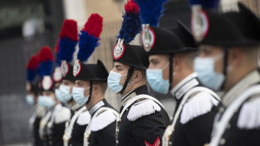 Italian carabinieri in face masks as they commemorate the country's Armed Forces Day.