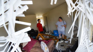 Shaun Vaine, left, and Michele Thrash, right, stand in their destroyed home at the River's Edge apartment complex.