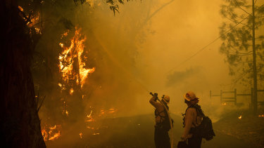 Firefighters battle a wildfire called the Kincade Fire in Sonoma Country, California.