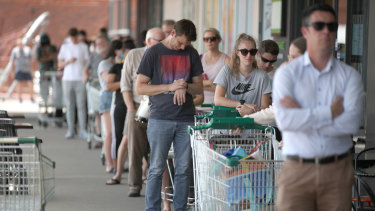 People queuing outside a Woolworths supermarket at West Torrens in Adelaide after the lockdown was announced.