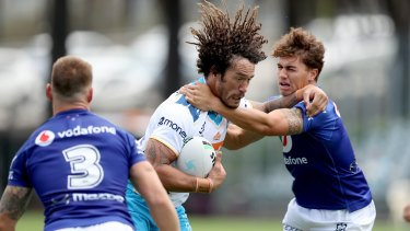 Titans forward Kevin Proctor battled hard in a tough first outing for the Gold Coast in 2021.