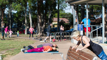 People exercising in Willoughby Park, resisting the urge to be sedentary during the COVID-19 crisis.