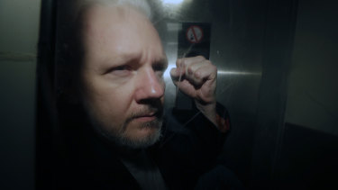 WikiLeaks founder Julian Assange being taken from court in May.