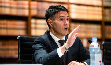 NSW Customer Service Minister Victor Dominello says the gambling industry should be in charge of developing a cashless poker machine card, not government.