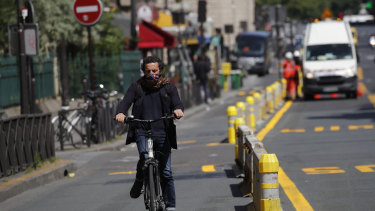 A man rides his bicycle on a new bike lane in Paris.