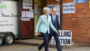 British PM Theresa May and Philip May, her husband, departing after casting their votes in the European Parliamentary elections on Thursday.