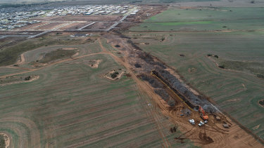 The Wyndham Vale rail stabling yard now under construction is just north of housing estates.