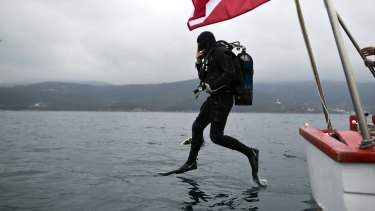 Lead archaeologist Dimitris Kourkoumelis dives to the shipwreck.