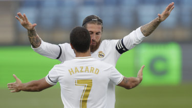 Ramos celebrates with Eden Hazard during the 3-1 victory.