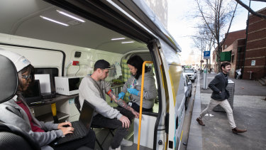 Cohealth street doctor Kate Coles treats Tim Williams in the mobile medical clinic.