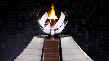 Naomi Osaka of Japan lights the Olympic cauldron with the Olympic torch.