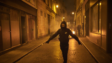 A protester walks the streets of Paris.