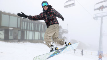 A snowboarder takes a jump at Mt Buller Ski Resort on Saturday.