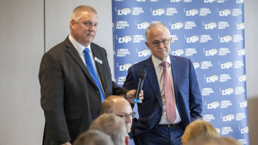 Prime Minister Malcolm Turnbull during an earlier appearance with the LNP's candidate for Longman, Trevor Ruthenberg.