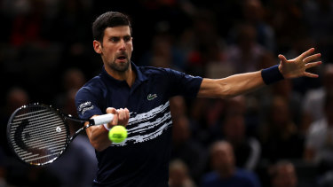 Novak Djokovic of Serbia returns a forehand in his semi-final against Grigor Dimitrov in Paris.