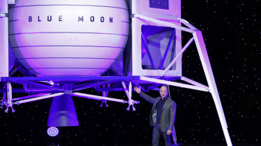 Jeff Bezos in front of a model of Blue Origin's Blue Moon lunar lander on Thursday.
