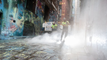 Cleaning in Melbourne's Hosier Lane, where masked killjoys paint-bombed popular street art.