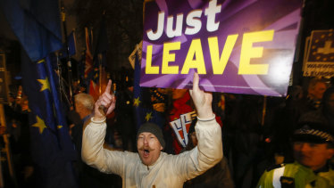 A pro-Brexit protester shouts slogans outside the Houses of Parliament.