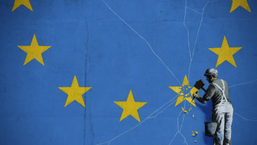 A mural by street artist Banksy near the Dover ferry port shows an EU star being chiselled away from the flag.