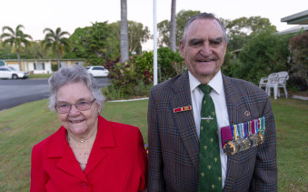 VC recipient Keith Payne with his wife Flo at dawn on Anzac Day in Mackay, QLD, this year.