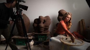 Isadora Vaughan  being filmed making art.