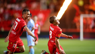 Firing home: Riley McGree lights up after scoring in the FFA Cup final for Adelaide.