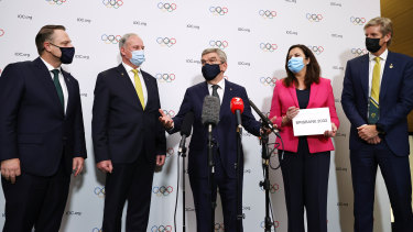 President of the International Olympic Committee Thomas Bach, centre, with members of the Brisbane 2032 delegation. From left, Lord Mayor of Brisbane Adrian Schrinner, federal minister for sport Richard Colbeck, Queensland Premier Annastacia Palaszczuk and three-time Olympic gold medallist James Tomkins.