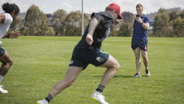 Andrew Heffernan keeps an eye on rugby league stars Blake Austin and Sia Soliola.