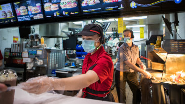 Staff at McDonald's in Boronia wearing masks on Tuesday.