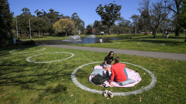 'Physical-distancing circles' in Princes Park, Carlton, on Friday.