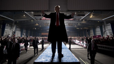 President Donald Trump gestures to the audience as he departs a rally at Southern Illinois Airport in Murphysboro, Illinois.