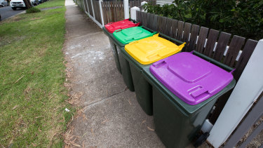 The new purple-top bin will be for glass recycling.