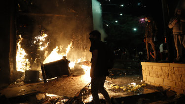 Protesters set fires at the third precinct station of the Minneapolis Police Department.