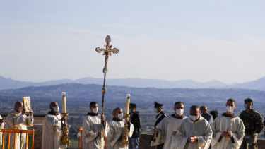 A procession walks through the streets of Assisi, Italy, prior to the beatification ceremony of 15-year-old Carlo Acutis.
