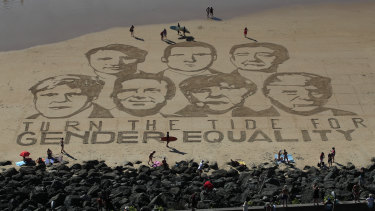 A portrait of G7 leaders is drawn into the sand over the headline 'Turn the tide for Gender Equality' in Biarritz, France, ahead of the 2019 summit.