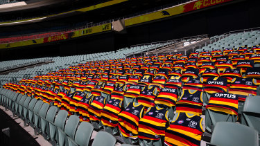 Crowded out: The absent Crows cheer squad marked their patch prior to the 2020 round 1 match against the Sydney Swans at an empty Adelaide Oval.