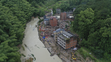 Rescuers search for victims of a landslide triggered by Typhoon Lekima in Yongjia county in eastern China's Zhejiang province.